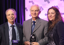 Dr. Hanus receiving his award from Dr Ethan Russo and Steph Sherer